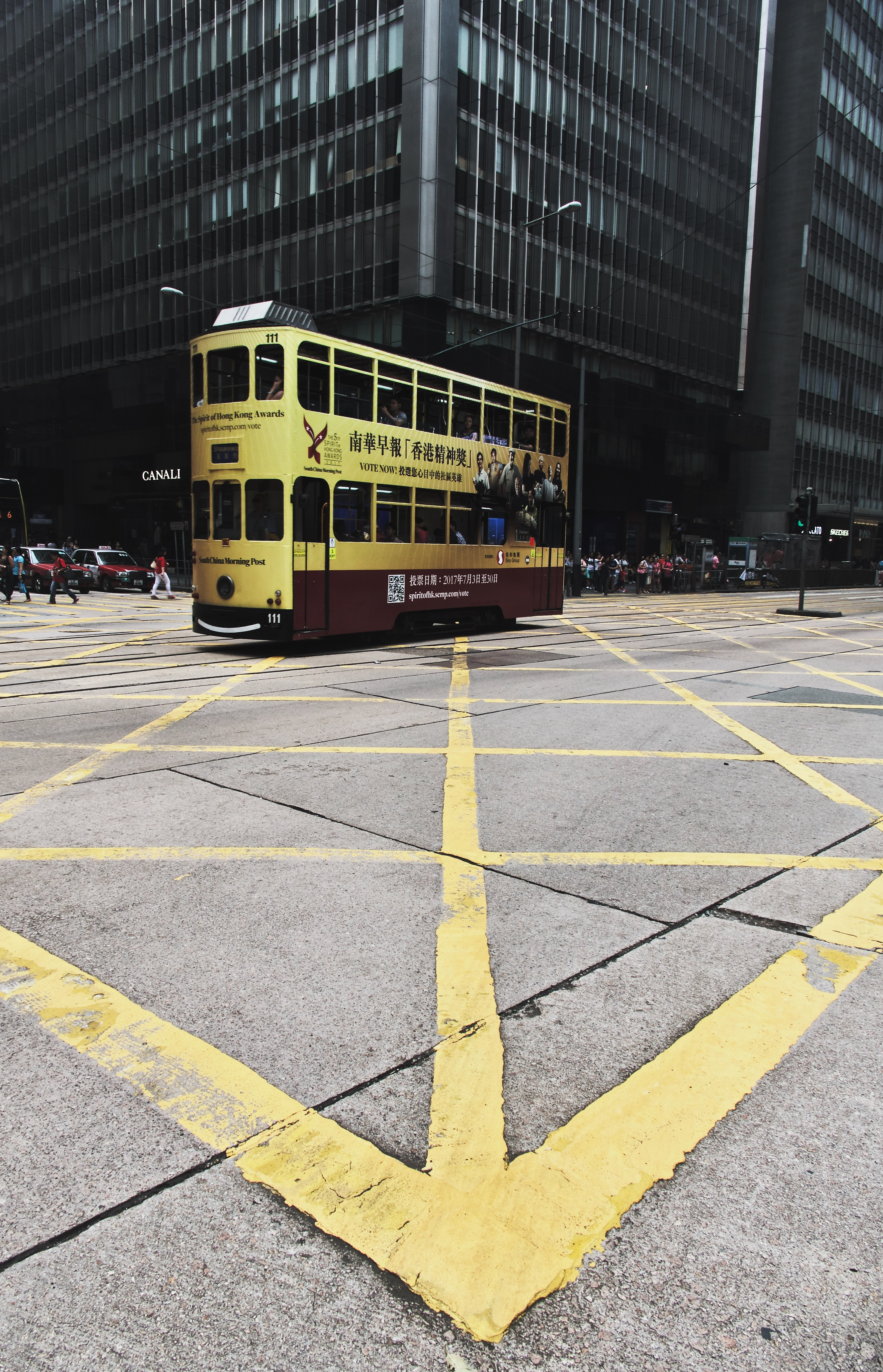 yellow dual bus on road