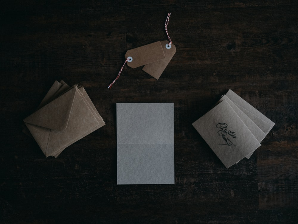 assorted-color card and envelopes
