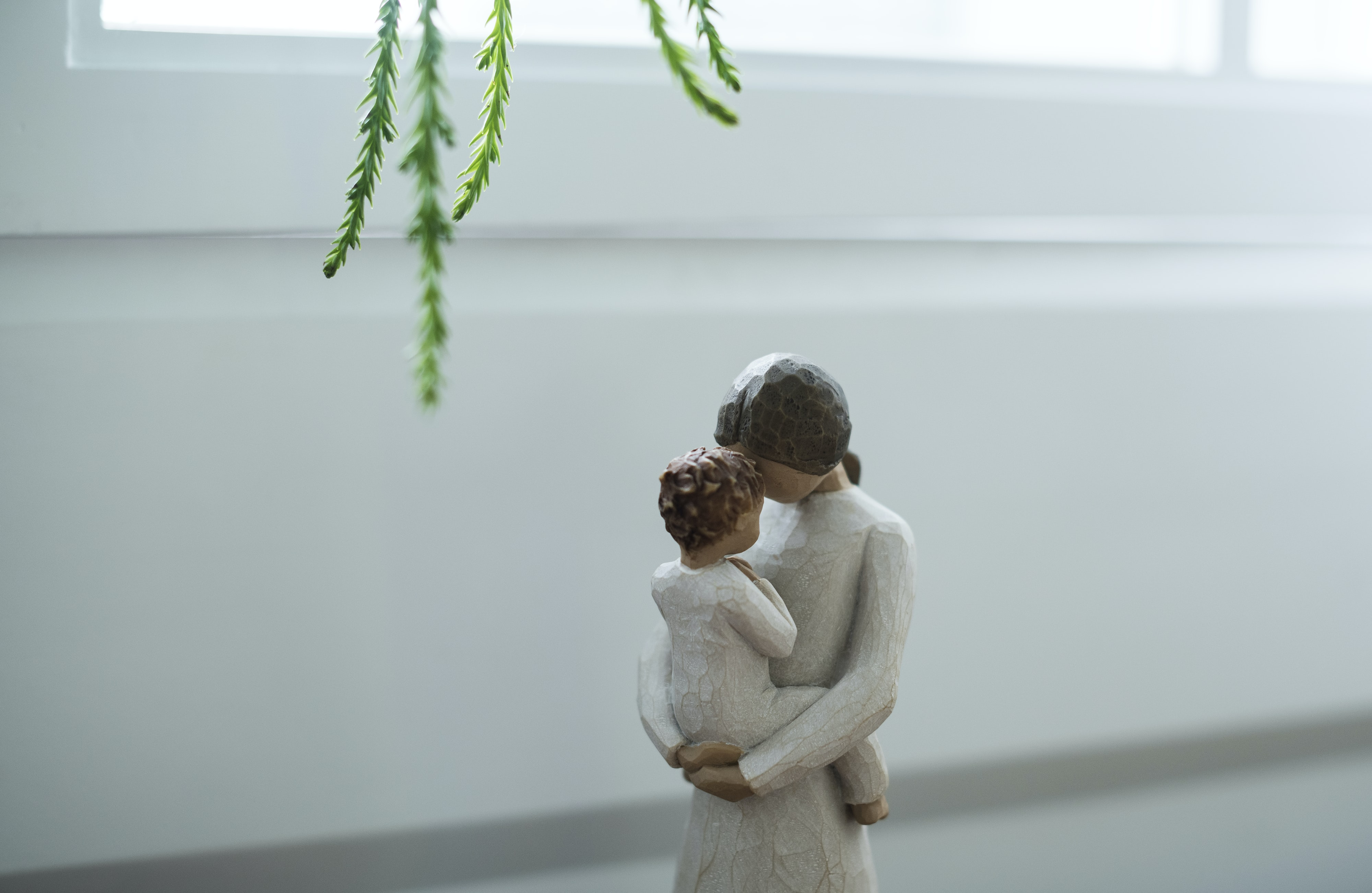 ceramic woman carrying baby figurine