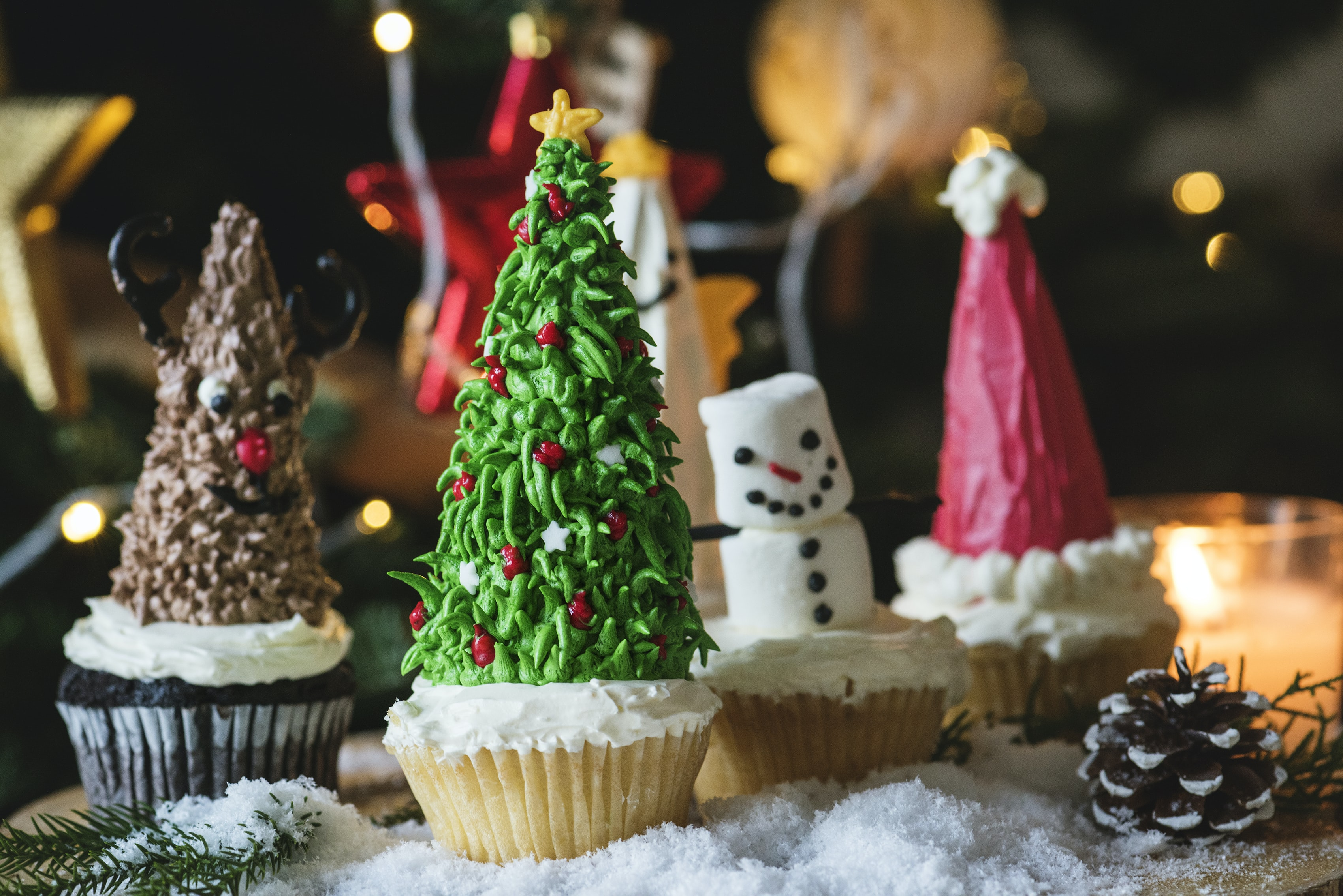 selective focus photography of Christmas-themed cupcakes