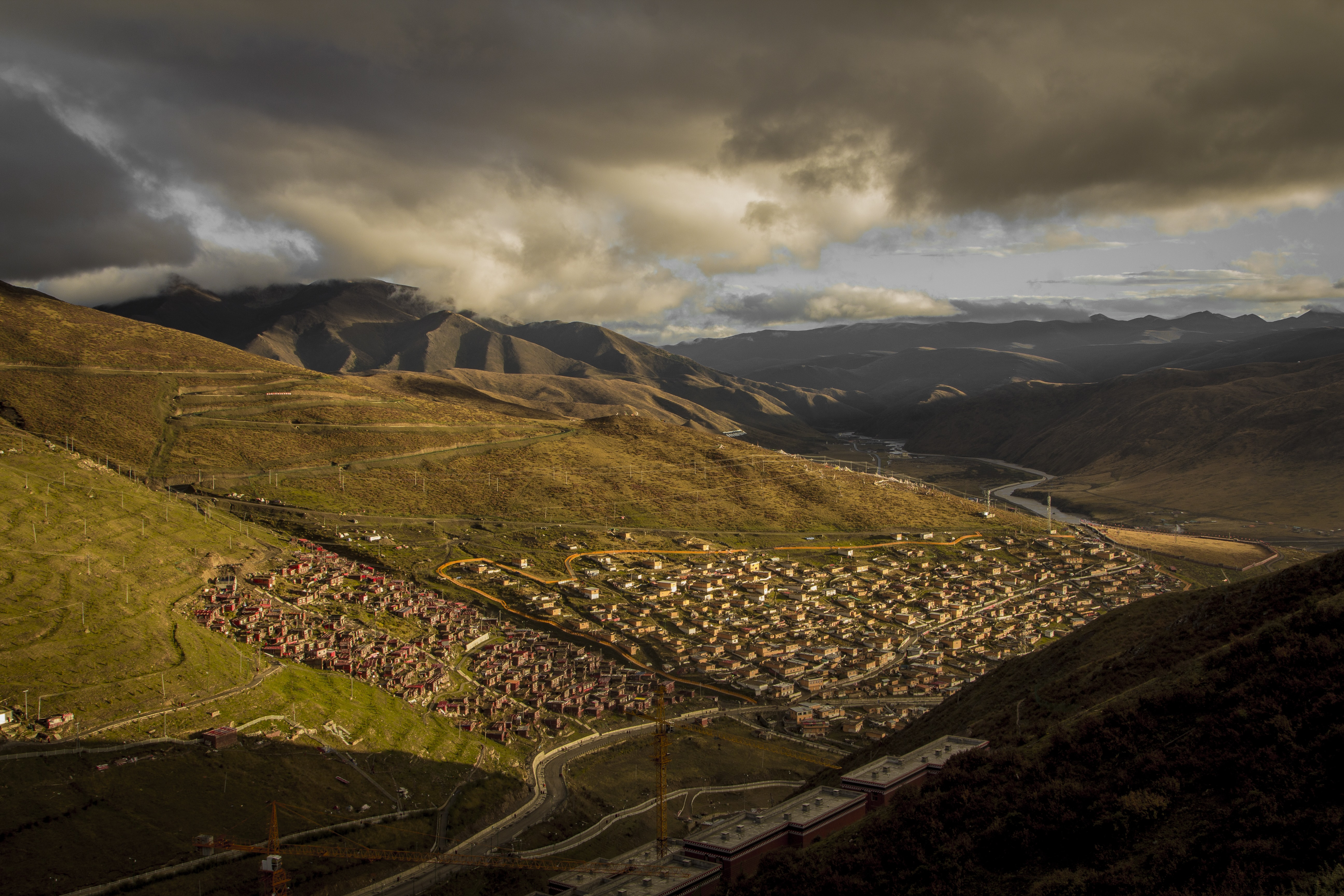aerial photography of town on mountain foot during daytime