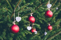 green Christmas tree with red ornaments