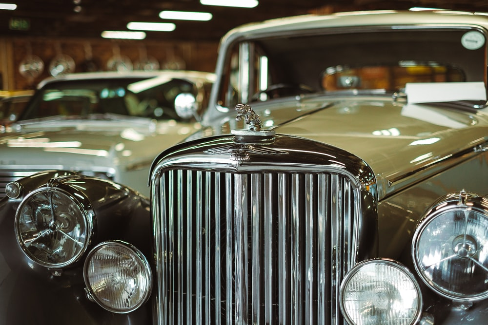 brown and gray classic car inside room with lights turned on