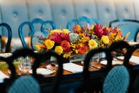 red and yellow flowers on brown wooden dining table