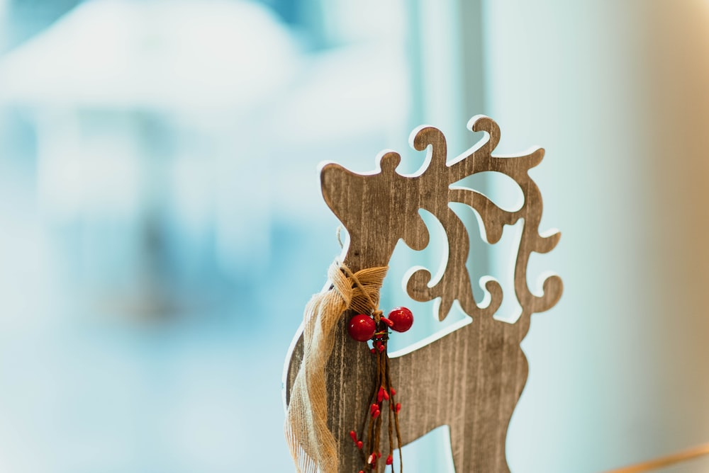brown wooden carved reindeer decoration on table