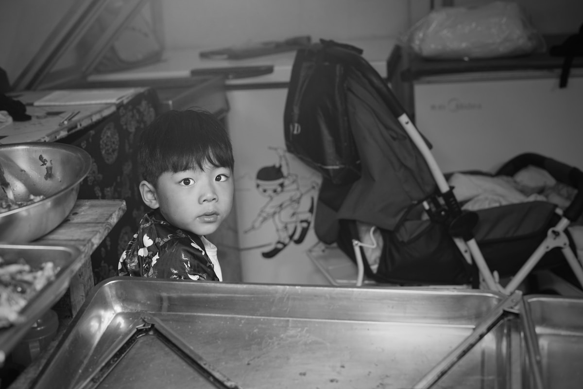 Black + White photo of Young Asian Boy