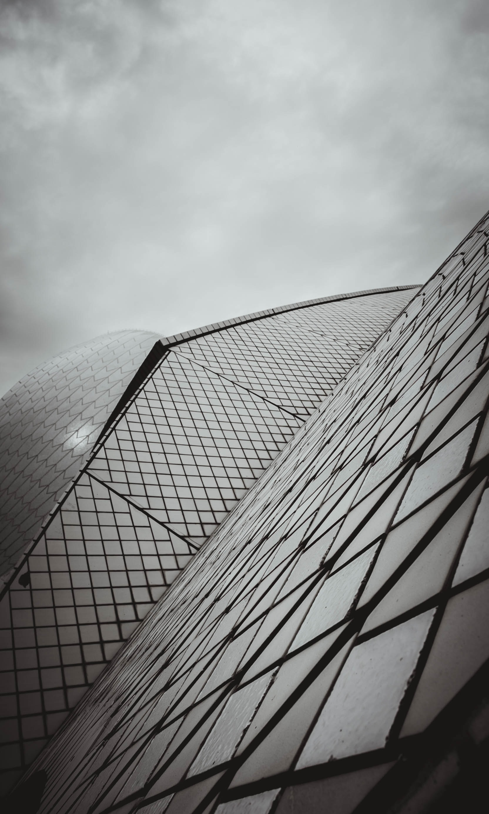 low angle photography of building under cloudy sky