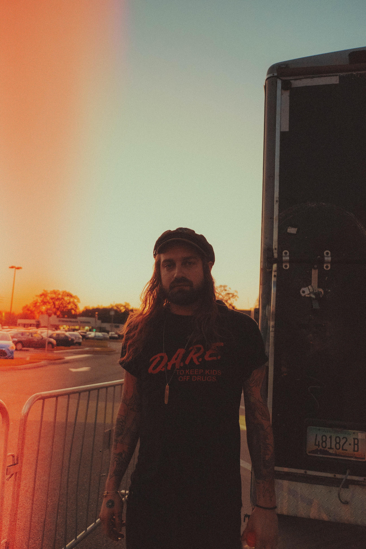 man standing beside box van