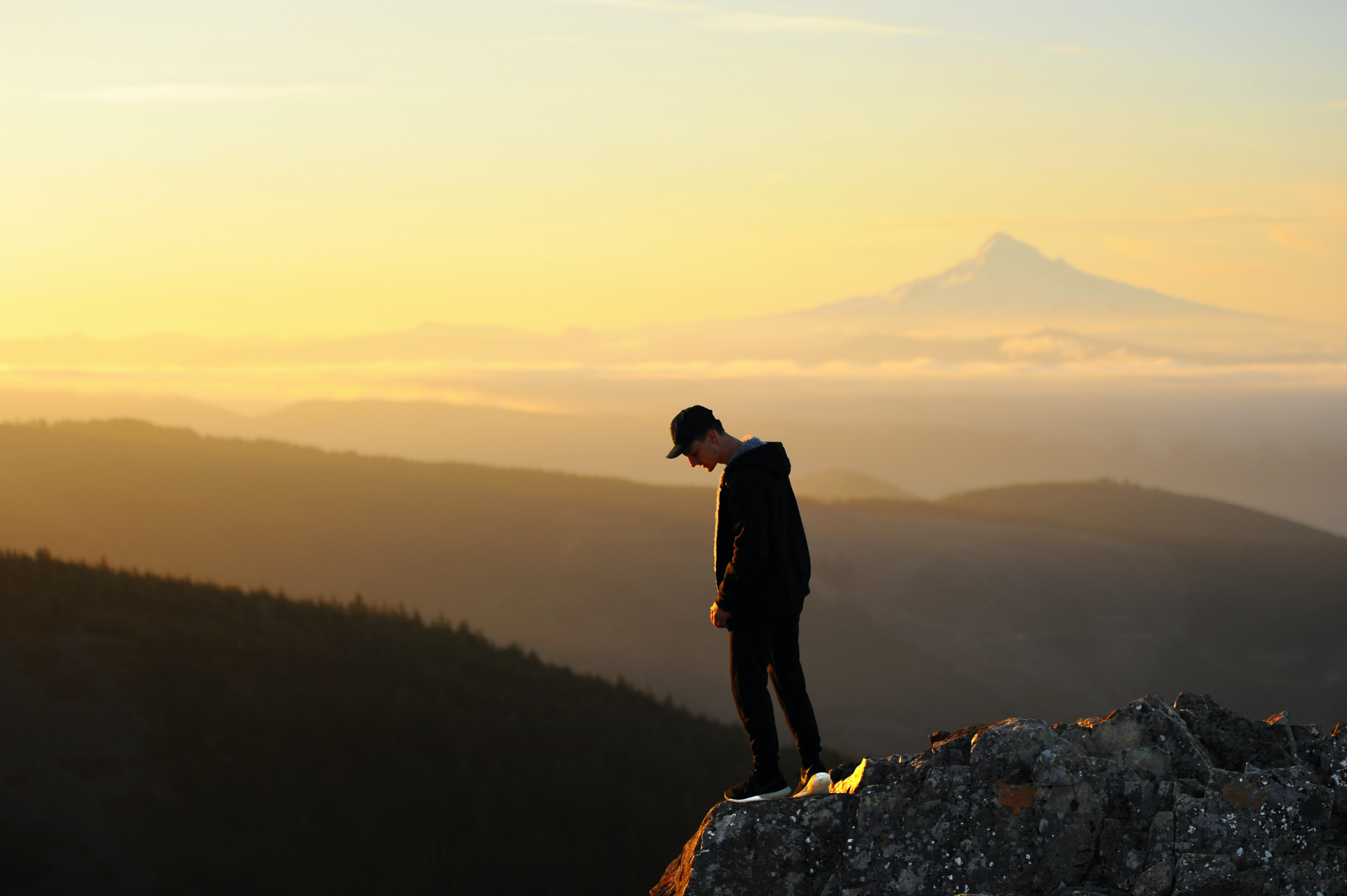 man standing on cliff