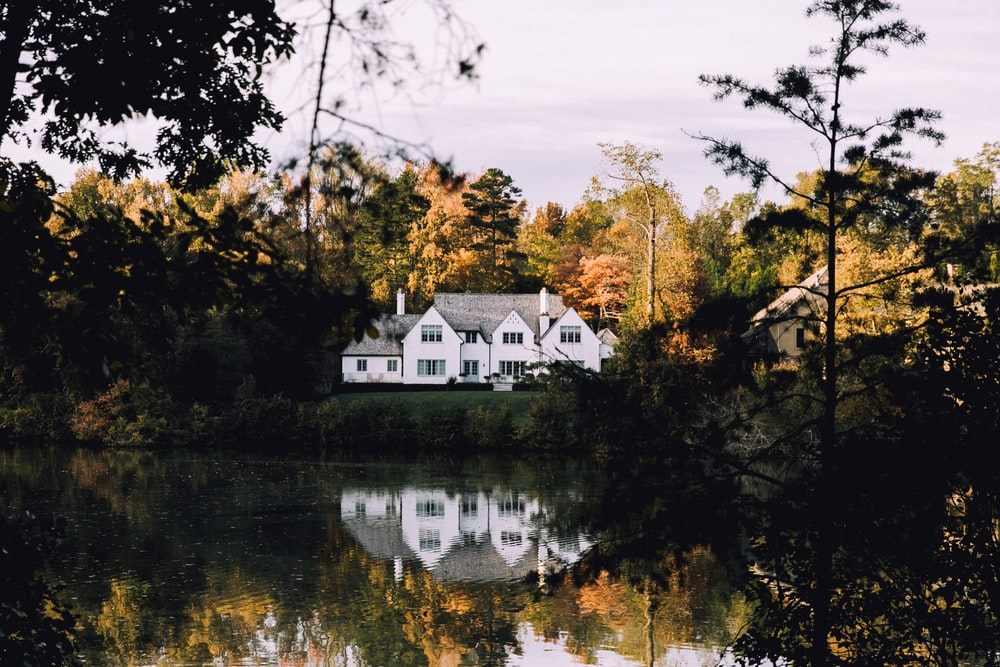 white concrete house near river