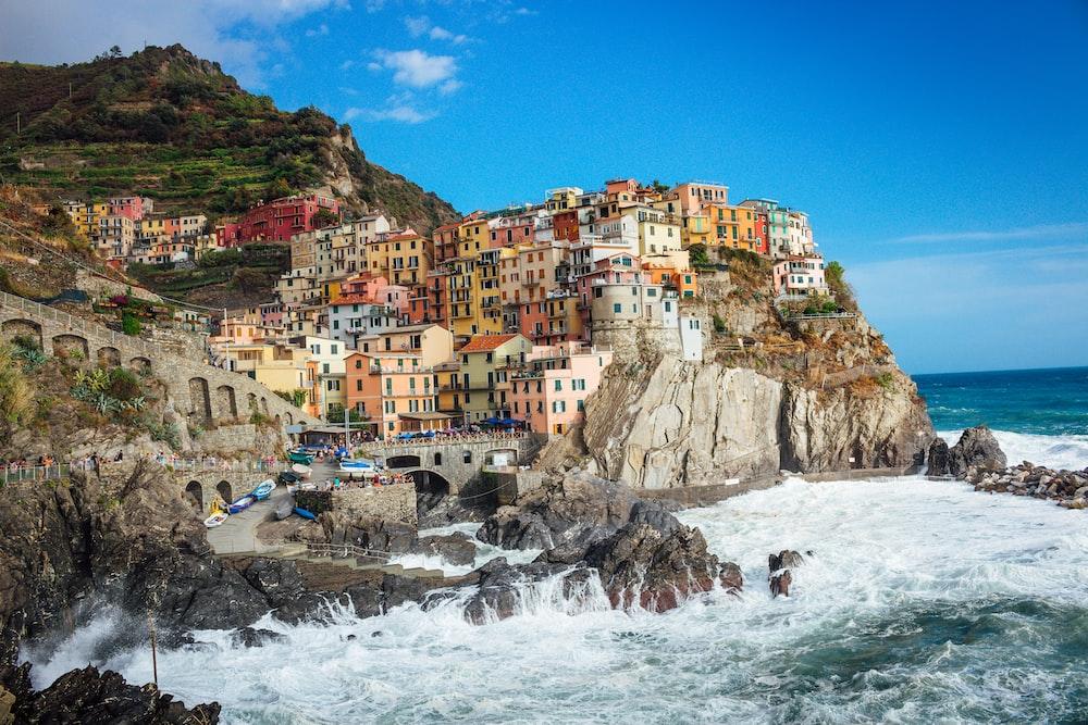 multicolored concrete houses near cliff