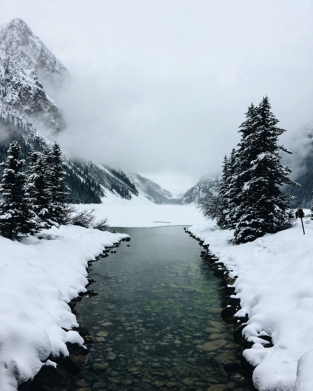 river at glacier mountain with fogs