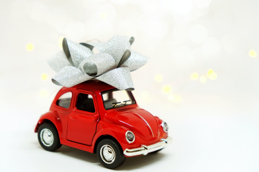 red Volkswagen Beetle miniature gift with gray ribbon