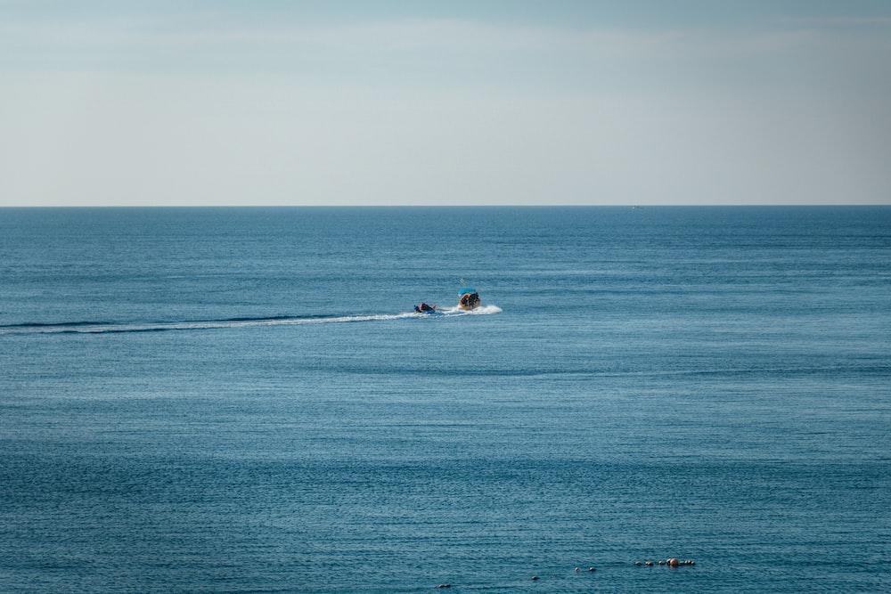 boat on ocean during daytime