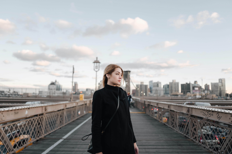 woman standing on Brooklyn Bridge
