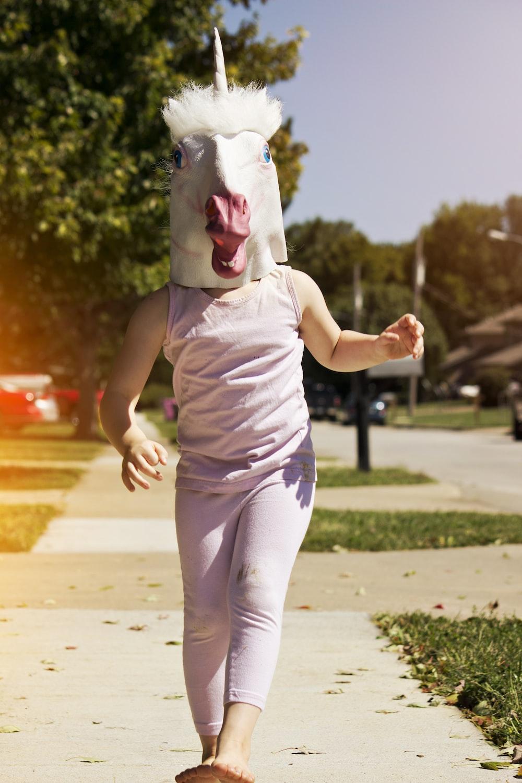 person wearing unicorn hat while walking outside
