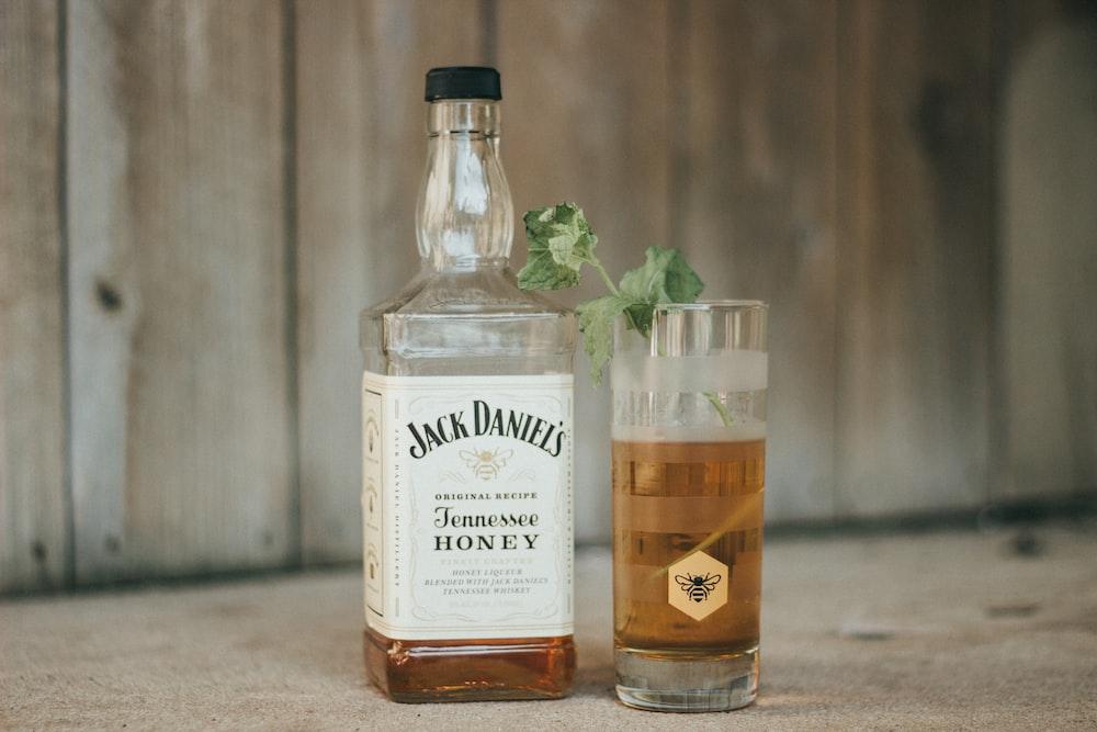 Jack Daniels tennesse whisky bottle near glass