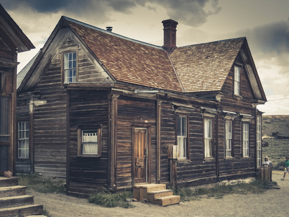 brown wooden house on ground