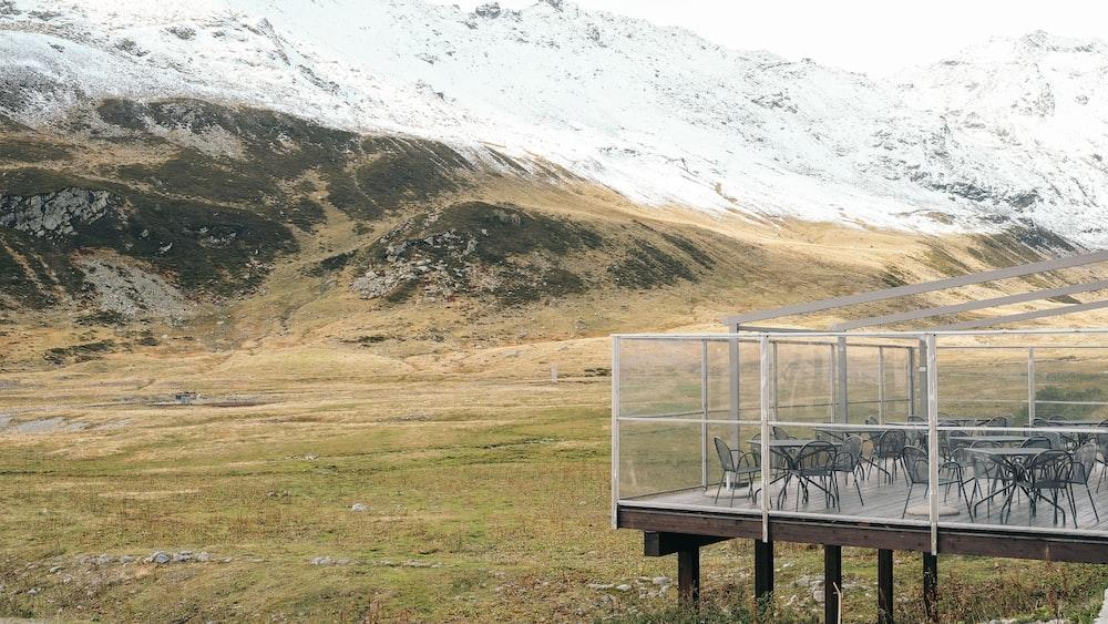 chairs near mountain photo