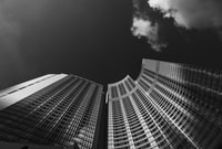 low angle grayscale photography of skyscraper