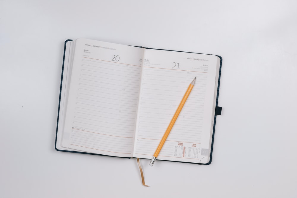 pencil on opened notebook