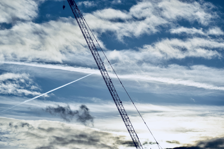black metal heavy equipment under blue sky
