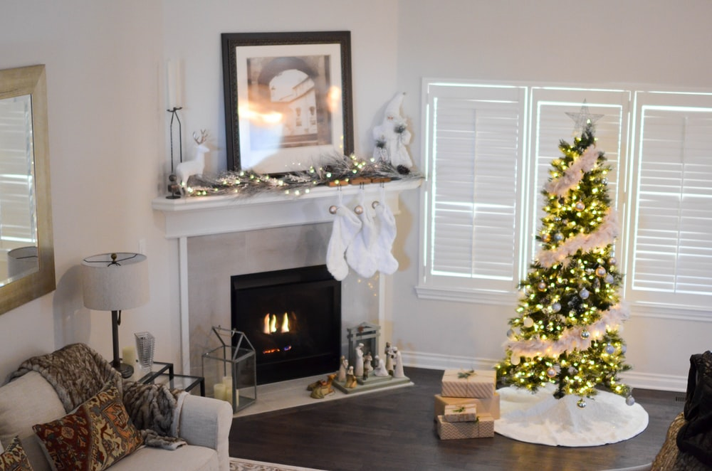 purchase cheap 60ed6 11c6f Christmas tree with string lights turned on near electric ...