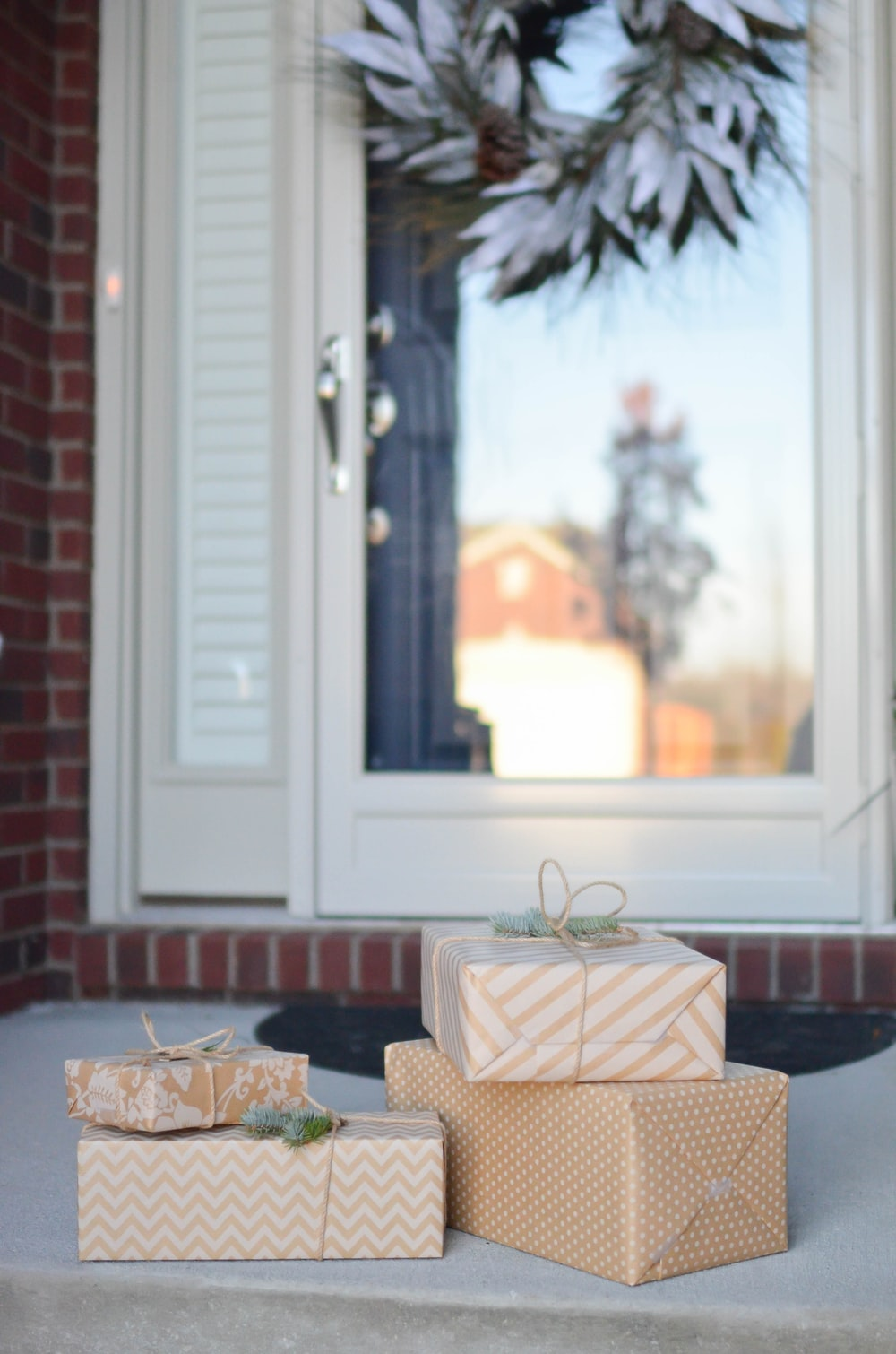four brown gift boxes near white door