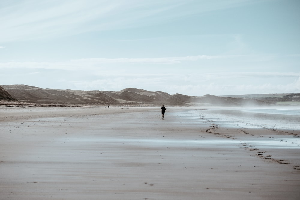 person running on desert