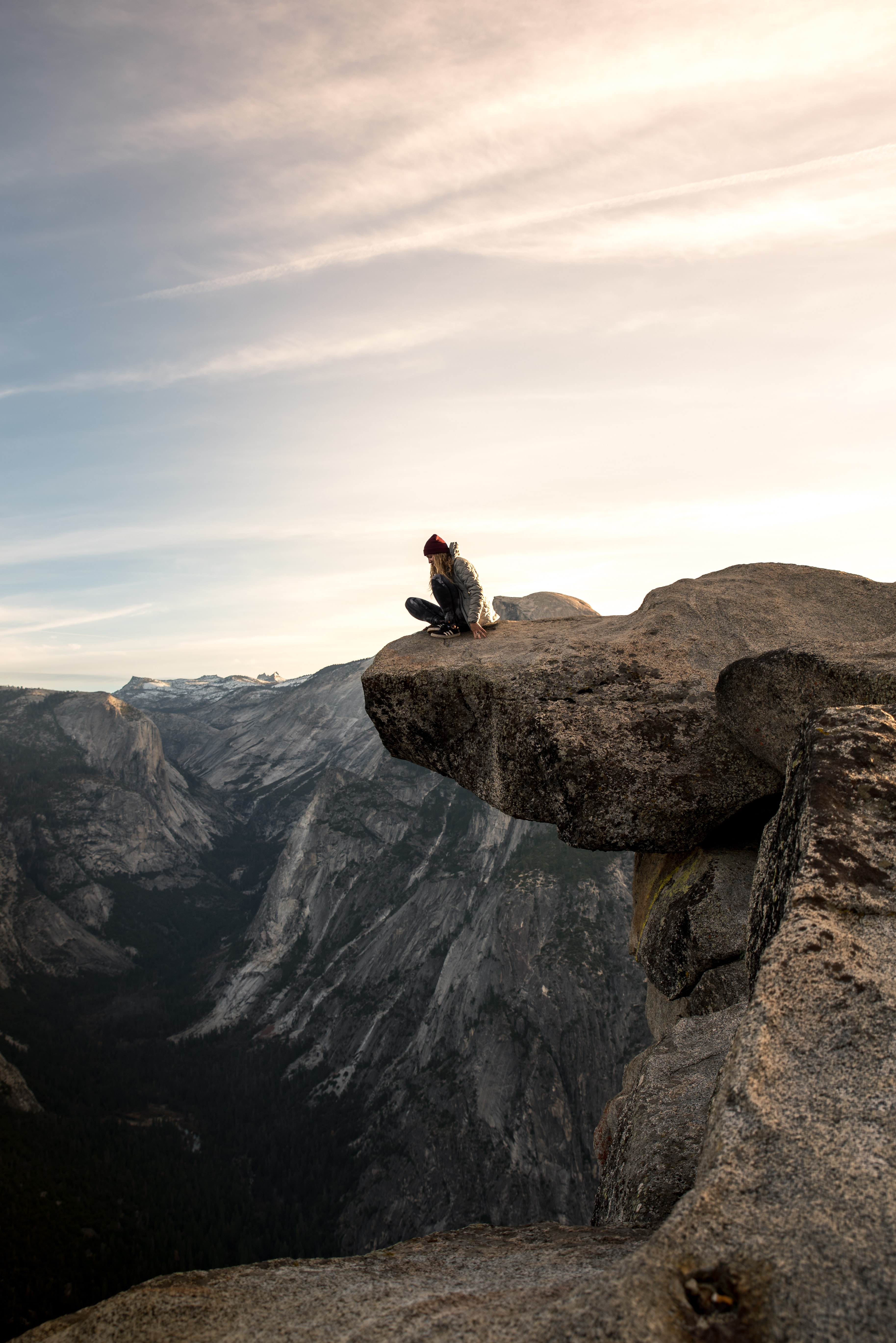 person sitting on brown mountain