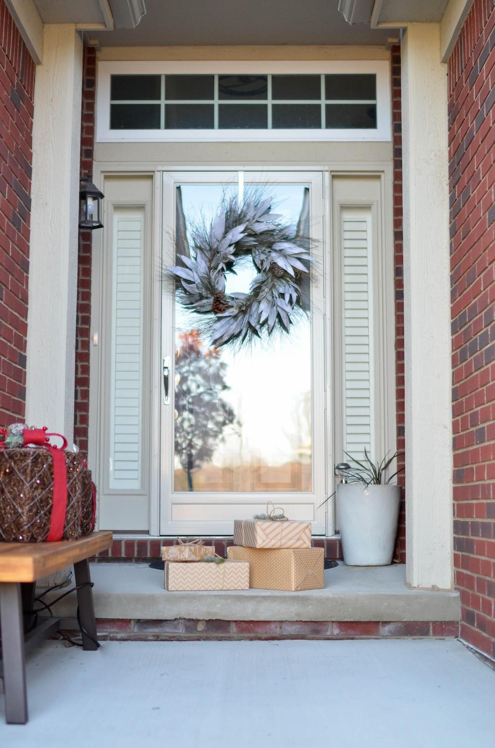 wreath hanging on full-lite door of house