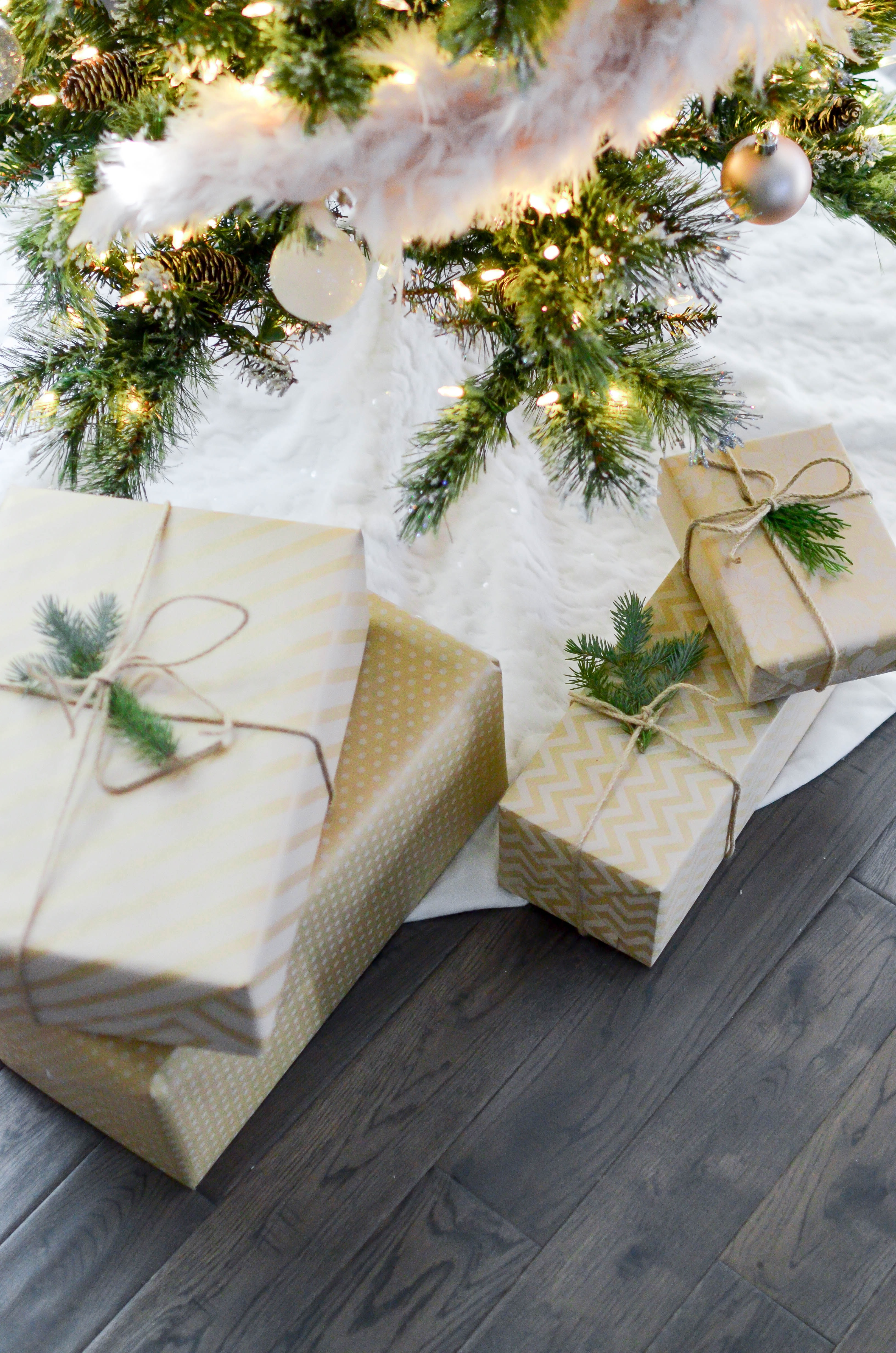 four gift boxes under Christmas tree