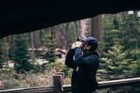 man taking picture using camera