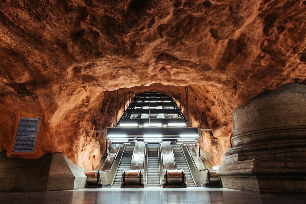 empty escalator inside cave building