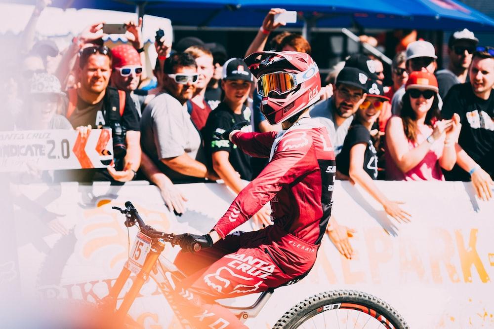 man wearing red motocross helmet during daytime