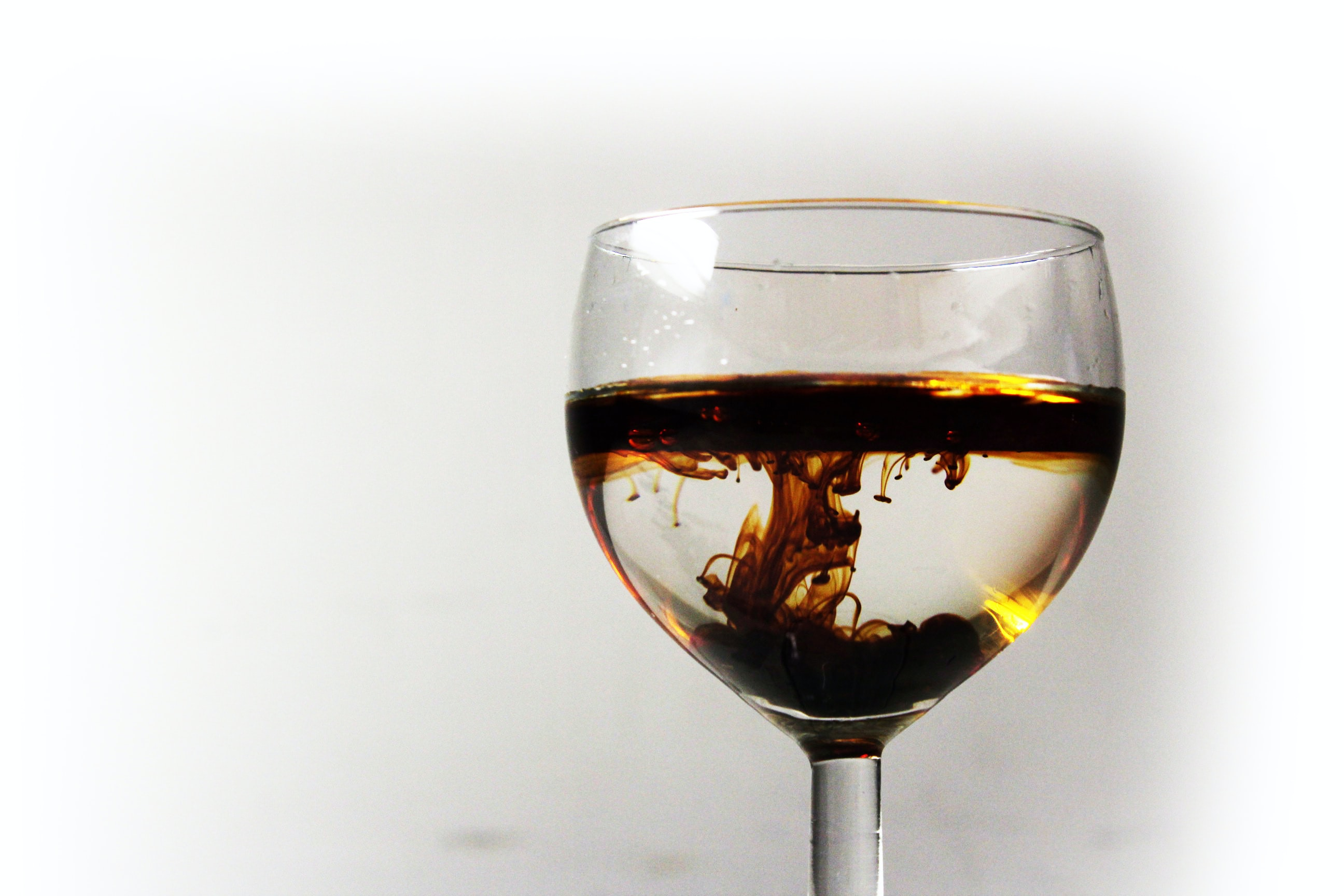 close up photography of clear long-stemmed wine glass