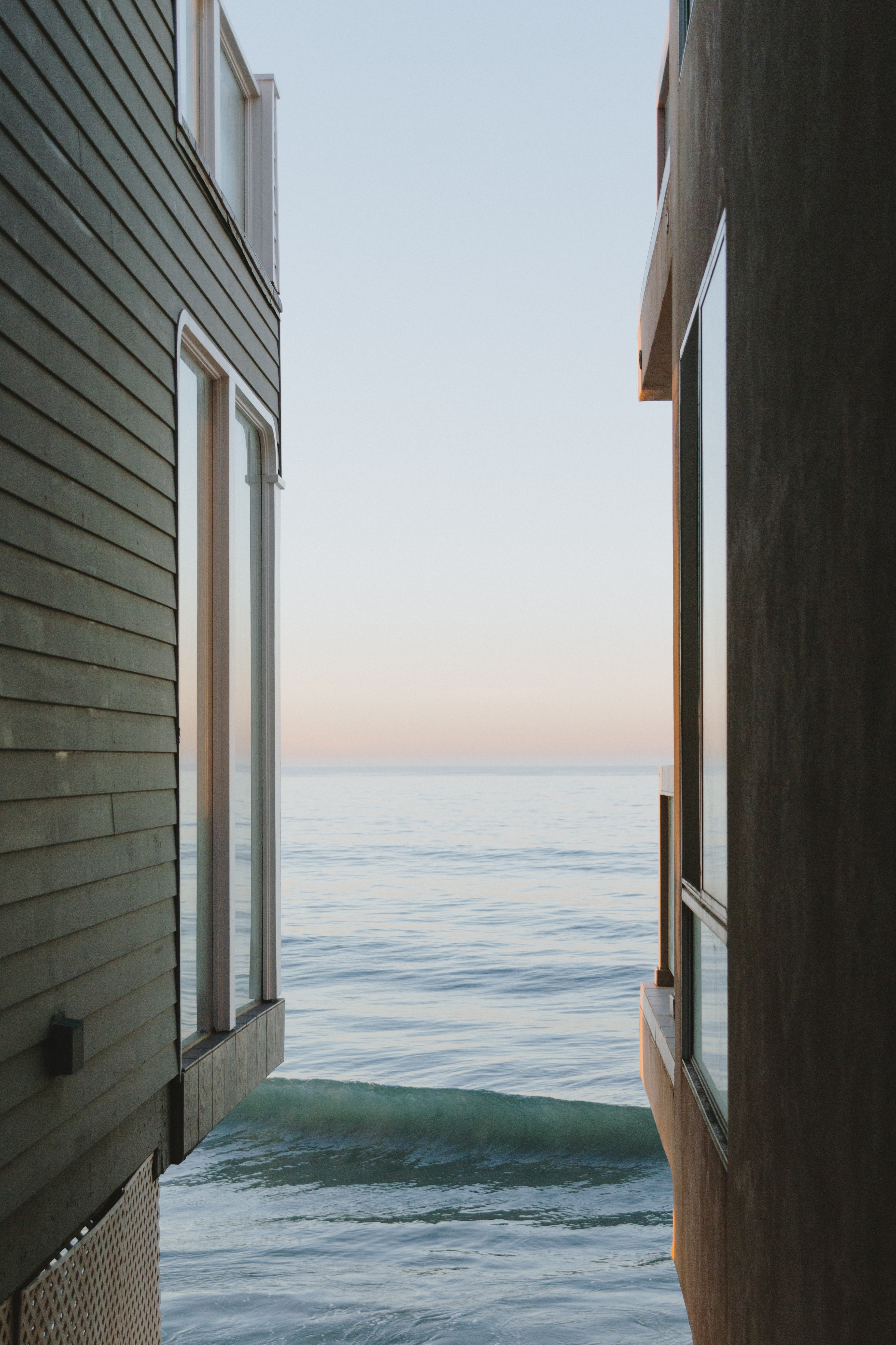 house in front of body of water