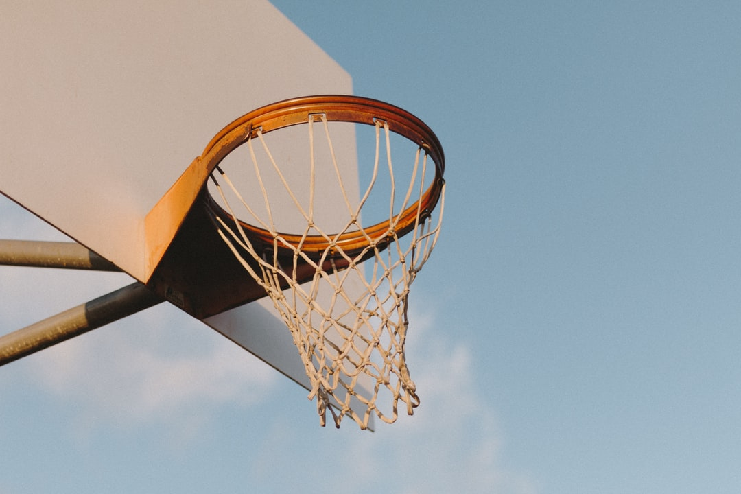 I challenged myself the other day to go out and shoot something with the first lens I ever bought: a plastic 50mm lens that cost me like $100. So I snapped it on my camera and headed up to the park down the street. The basketball court was empty and I loved the way the light was hitting the hoops, so I decided to shoot it. I'd say it was a successful challenge.
