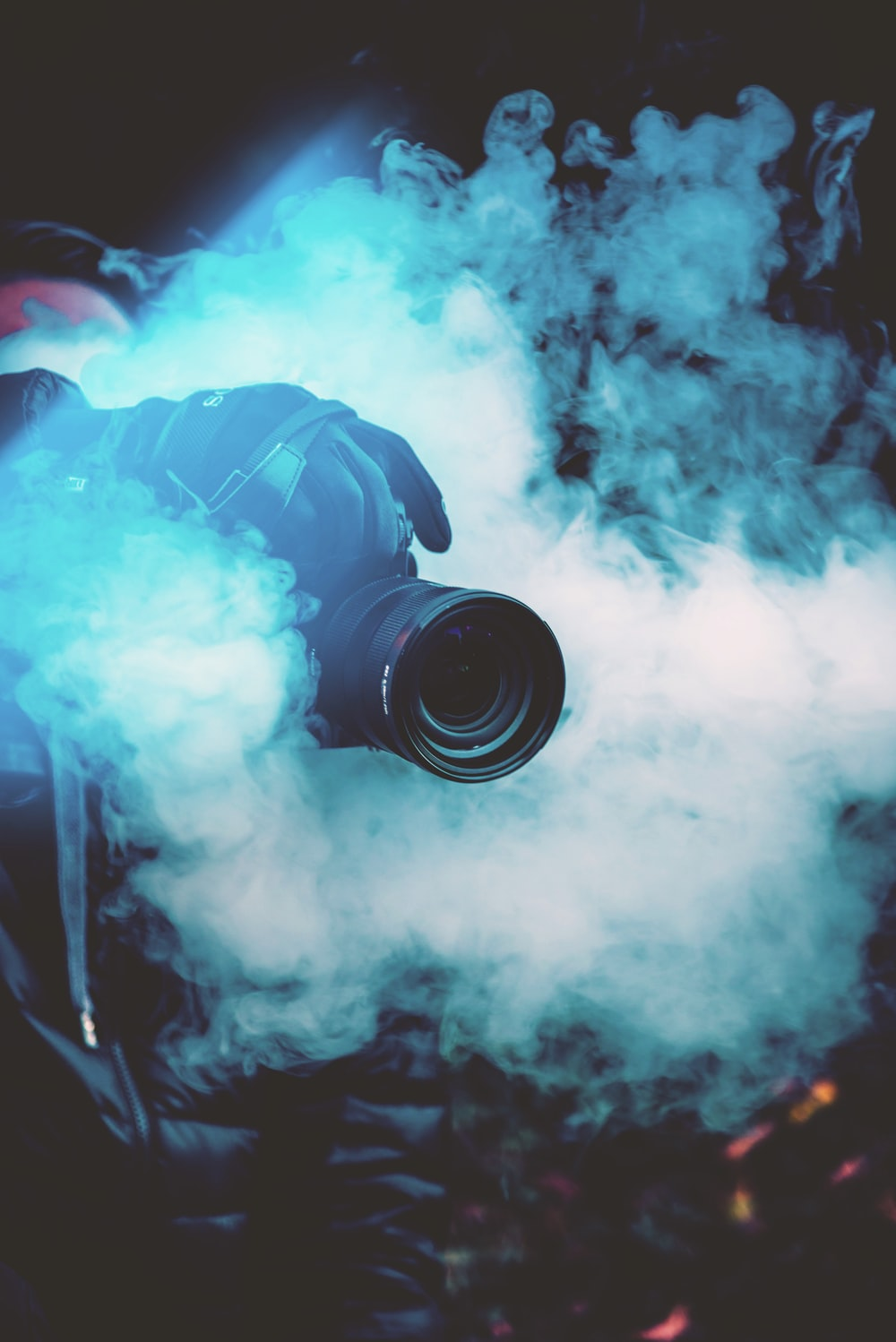 person holding DSLR camera with fogs