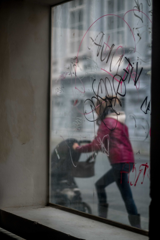 window pane with vandalism