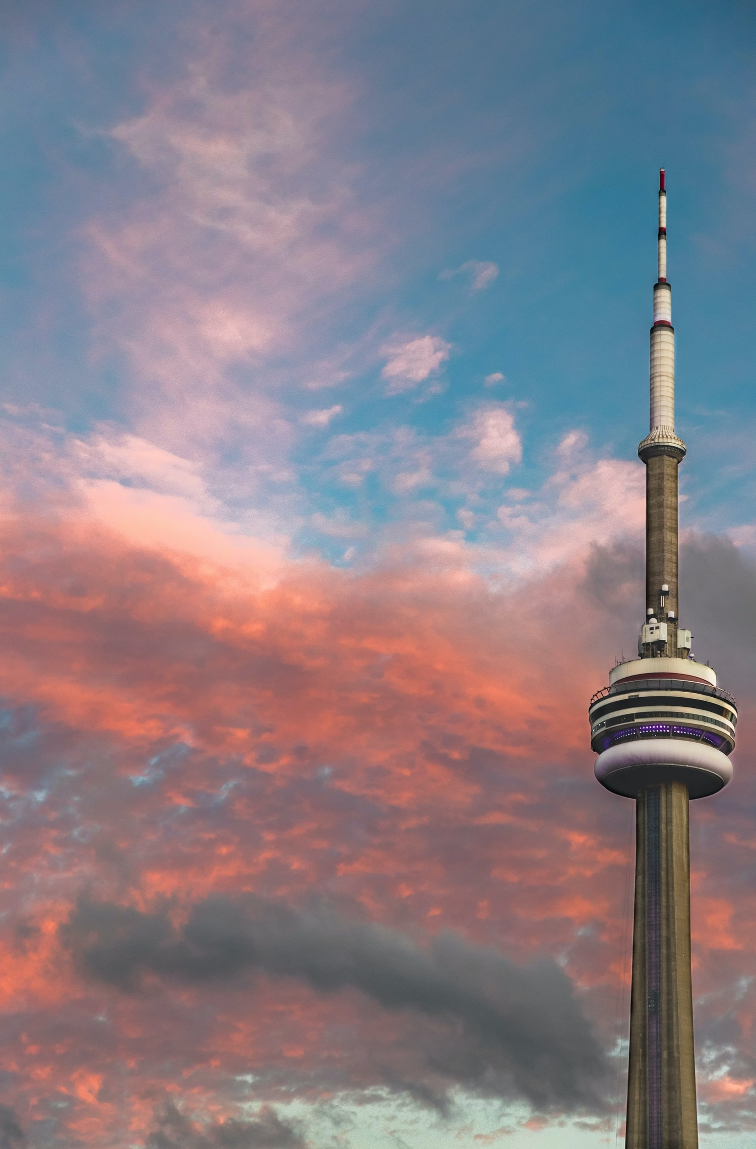 CN Tower under red and gray clouds