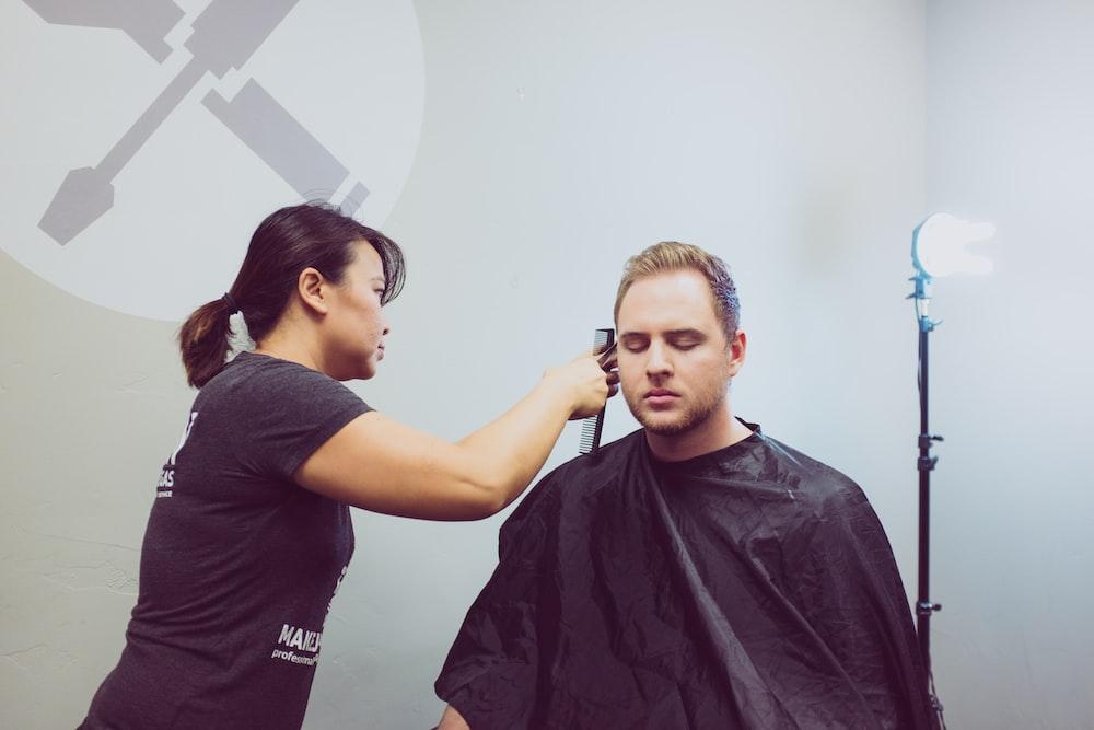 woman cutting man's hair