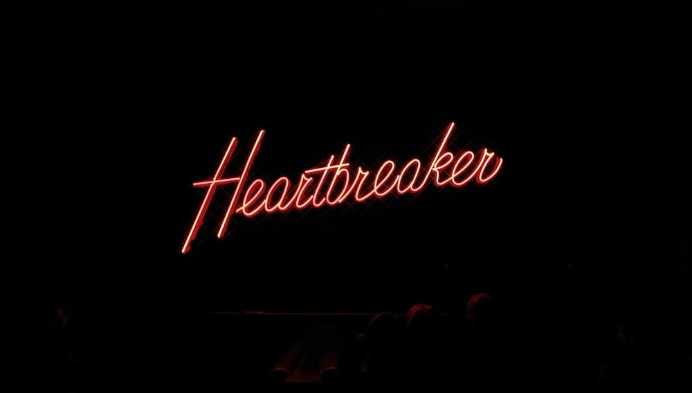 Heartbreaker neon signage on black background