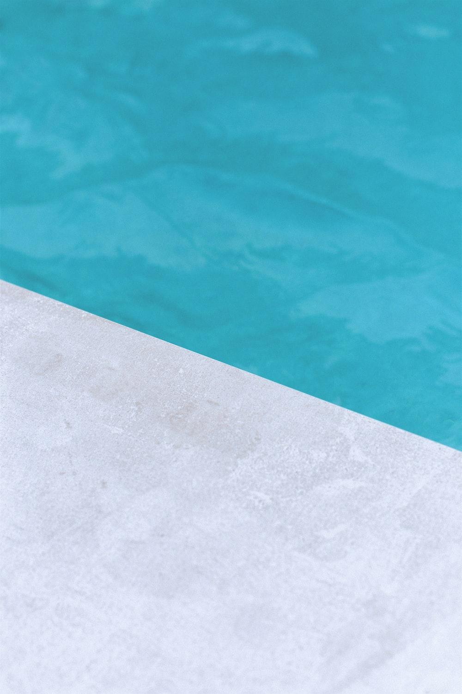 empty gray floor beside pool