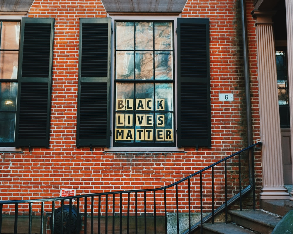 black lives matters poster on window