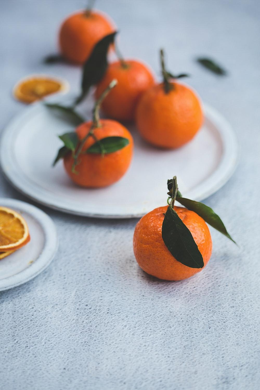 orange fruits on white plate
