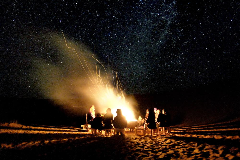 Silhouette Photography Of Group People Surrounding On Bonfire