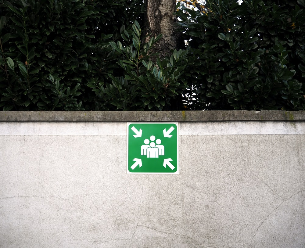 green and white signage