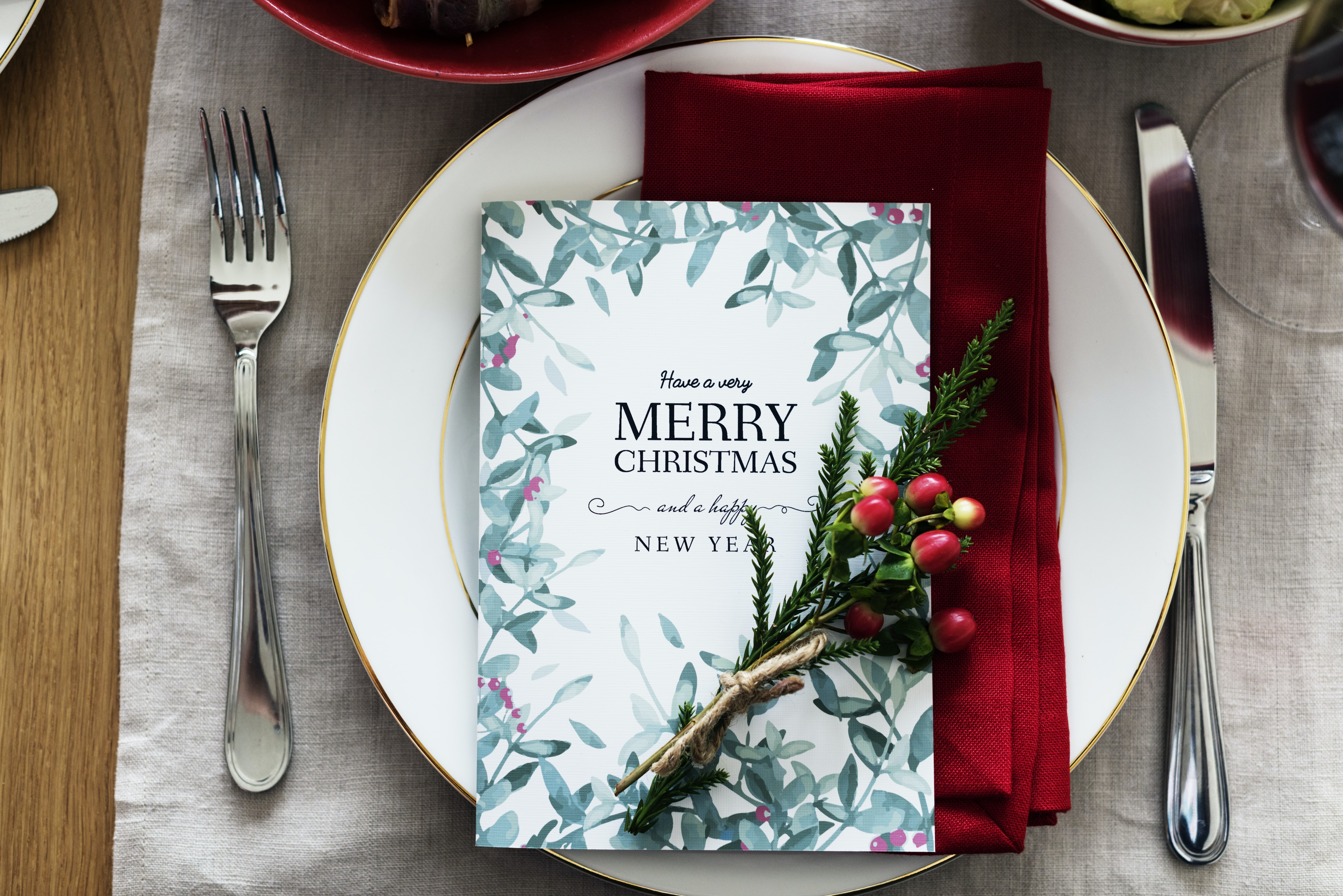 Merry Christmas book on plate with table napkin