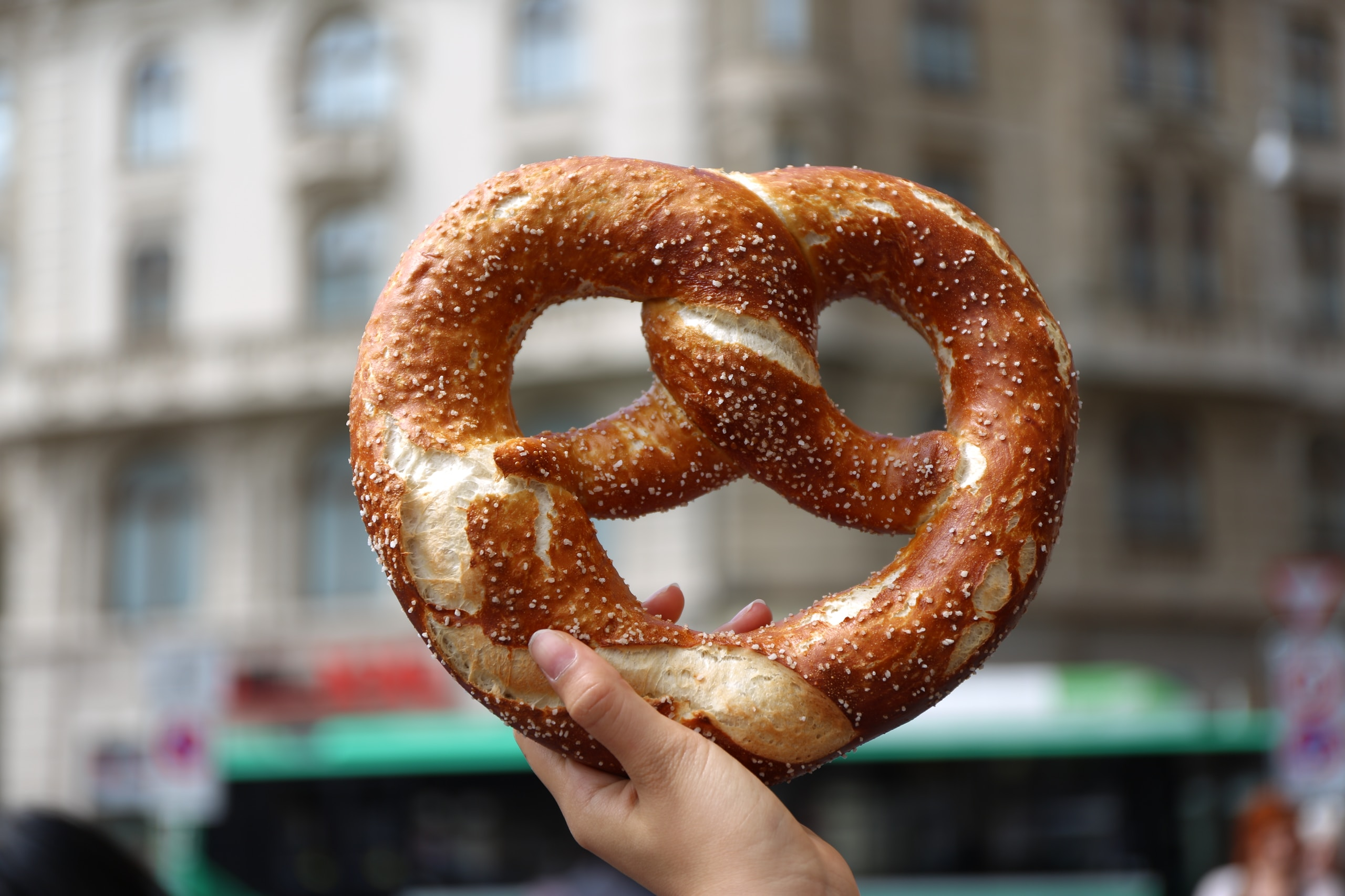 person holding pretzel